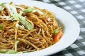 Chowmein in plate with sauce