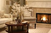 stock photo of cozy hearth  - Elegant living room with fireplace on - JPG