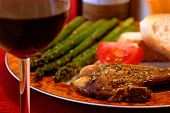 stock photo of red wine  - meal of porkchops - JPG