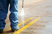 foto of wet pants  - powerwashing the parking lot and cleaning the stripes - JPG