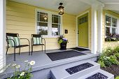 Covered Porch With Stairs. Small American Yellow House Exterior poster