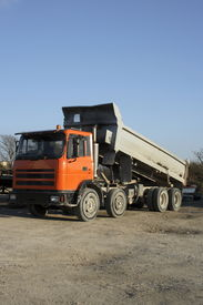 picture of dump_truck  - Dump truck tipping load - JPG