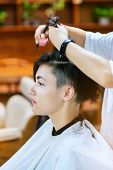 Beauty, hairstyle, treatment, hair care concept, young woman and hairdresser cutting hair at hairdre poster