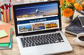 Flights Online Booking And Reservation. Search Flights On A Computer Laptop Screen, Office Desk Back poster