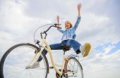 Pedaling Towards Happiness. Woman Feels Happy While Enjoy Cycling. Girl Rides Bicycle Sky Background poster