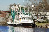 stock photo of bayou  - Shrimp Boat docked in the waterways of the bayou near New Orleans Louisiana - JPG