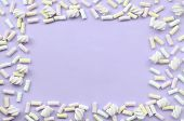 Colorful Marshmallow Laid Out On Violet Paper Background. Pastel Creative Textured Framework. Minima poster