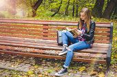 Beautiful Teen Girl Reading A Book. Teenage Or Young Adult High School Or College Student Studying I poster