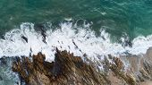 Aerial View Drone Shot Of Seascape Scenic Off Beach In Phuket Thailand With Wave Crashing On The Roc poster