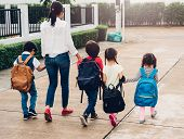 Children Kid Son Girl And Boy Kindergarten Walking Going To School Holding Hand With Mother Mom poster