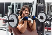 Strong Muscular Man Working Out With A Barbell poster