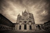 Siena Cathedral closeup as the famous landmark in medieval town in an overcast day in Italy. poster