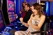 image of gambler  - Friends in Casino on a slot machine - JPG