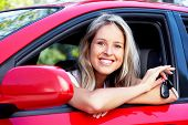 image of car key  - Happy young smiling woman with a car key - JPG