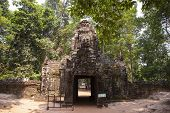 Ancient Ruins Of Ta Som Temple In Angkor Wat Complex, Cambodia. Tower With Buddha Face On Gate. Ston poster