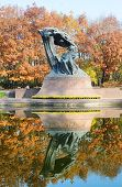 stock photo of chopin  - Polish pianist Frederic Chopin monument designed by Waclaw Szymanowski in 1907 in Royal Baths park in Warsaw Poland - JPG