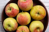 Ripe Apples On A Wooden Plate. Apples Close-up. A Bowl Of Organic And Ripe Apples poster