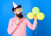 Man With Beard On Surprised Face Holds Air Balloons, Blue Background. Hipster In Star Shaped Glasses poster
