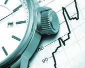 picture of stock market crash  - stock market graph and watch - JPG