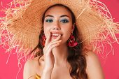 Image closeup of glamorous caucasian woman 20s wearing big straw hat smiling and looking at you isol poster