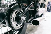 Detail Of A Motorcycle Rear Chain With Exhaust Pipes. Rear View Of A Motorcycle With The Focus On Ch poster