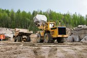image of oversize load  - Excavation and dump vehicle in a granite quarry - JPG