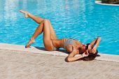 Portrait Of Sexy Tanned Slim Model Woman In Sunglasses And Striped Retro Bikini Have Relax And Enjoy poster