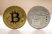 Bitcoin Gold And Silver Coin Placed On White Brown Background. Coin From Both Sides - Fron And Back  poster