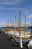 stock photo of sloop  - Traditional wooden sloops moored at the pier of Karlskrona marina Sweden - JPG