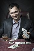 pic of sharpie  - Young adult handsome business man winner playing poker - JPG
