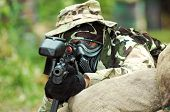 stock photo of gun shot wound  - Picture of paintball shooter aiming the target - JPG