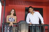 picture of caboose  - Attractive teenage couple standing on a red caboose together - JPG