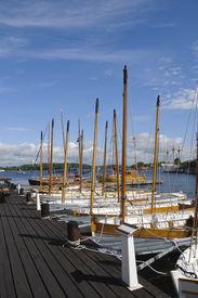 picture of sloop  - Traditional wooden sloops moored at the pier of Karlskrona marina Sweden - JPG