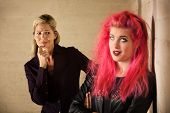 image of gullible  - Suspicious blond mother with annoyed teenage daughter - JPG