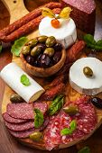 stock photo of cheese platter  - Appetizer catering platter with different meat and cheese products - JPG