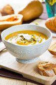 foto of butternut  - Butternut Squash Soup by loaf of bread - JPG