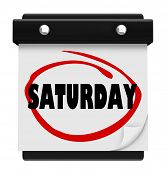 The word Saturday circled on a wall calendar to illustrate the weekend and serve as a reminder of im