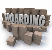The word Hoarding surrounded by cardboard boxes piled up in an out of control messy collection of it