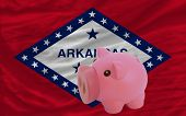 Piggy Rich Bank And  Flag Of American State Of Arkansas