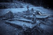 stock photo of moonlight  - Spooky Halloween graveyard in fog in moonlight - JPG