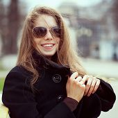 Young Woman In Glasses Smiles Fun
