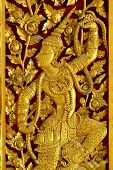 stock photo of woodcarving  - Thai woodcarving angle painted with golden color a - JPG