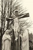 picture of inri  - monochrome jesus crucifix statue on a graveyard - JPG