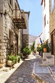 foto of hydra  - A picturesque alley on the Greek island Hydra which depicts some of the local architecture - JPG