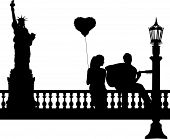 Couple in love where a guy plays guitar girl in New York silhouette