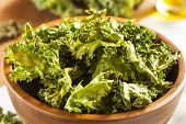 stock photo of kale  - Homemade Organic Green Kale Chips with salt and oil - JPG
