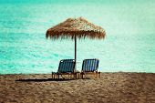 beach sun beds and straw umbrella on the beach