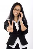 Attractive Businesswoman On The Phone Victory Sign