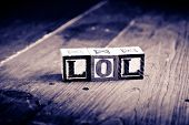 picture of lol  - alphabet wood blocks forming the word lol - JPG