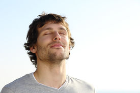 picture of breathing exercise  - Attractive man breathing outdoor with the sky in the background - JPG